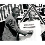 pic8930. Bernie Grant signs 'Boycott Apartheid 89' petition