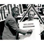 pic8930. Bernie Grant signs 'Boycott Apartheid 89' petition